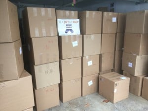 Boxes of new socks collected by The Joy of Sox getting ready to be delivered to homeless shelters.