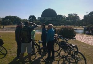 Bike tour with the Buenos Aires Planetarium in the background. Book a bike tour online with Wander Argentina