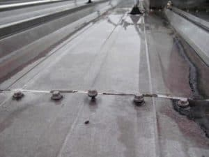 Lifted fasteners on a metal roof that can cause the roof to leak water