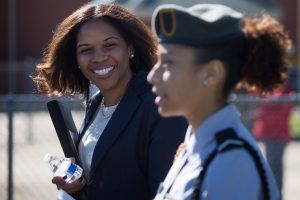 Dr G speaks with a JROTC student at Olin High School before a pass in review ceremony. She grew up in the Birmingham suburb of Hueytown. (AJ Reynolds/Brenau University)