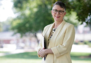 President Anne A. Skleder outdoors