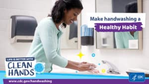 woman demonstrates washing hands to stay healthy and prevent spreading disease