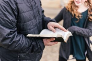 Dads are important to their daughters. Picture of dad sharing Bible with daughter