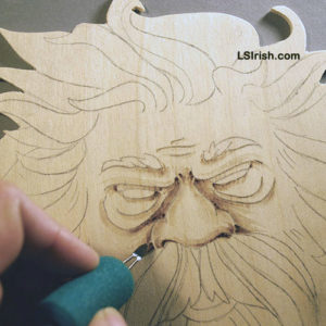 Shading the wood spirit face in pyrography