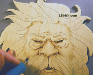 wood burning the wood spirit face