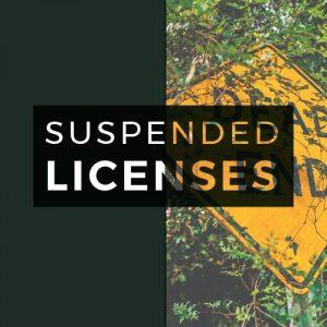 suspended licenses text overlaid on dead end sign and dark green background