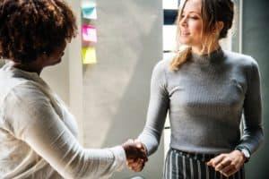 two-women-shaking-hands