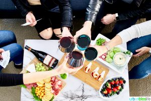 Cheers to girls night in game night with red wine and appetizers