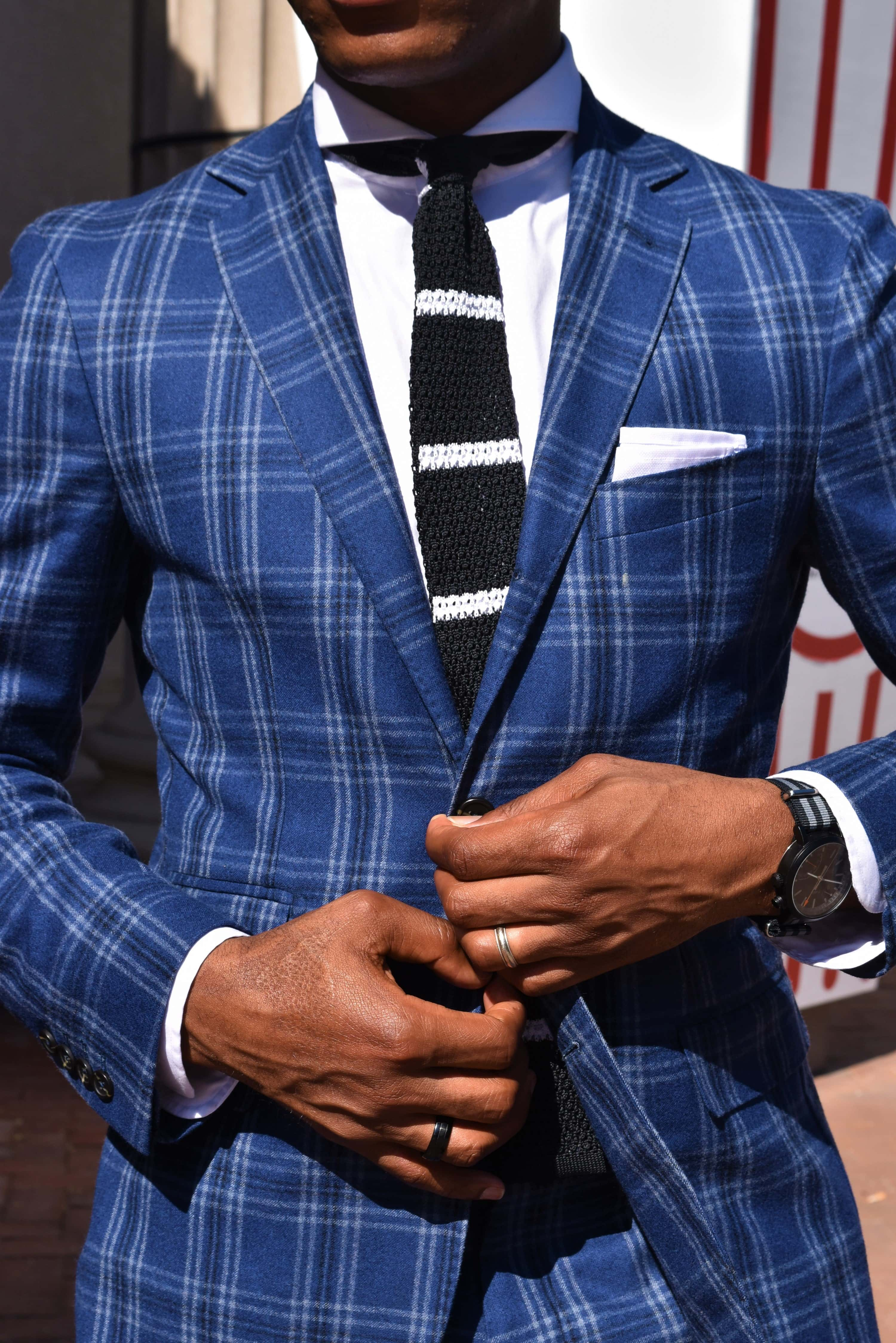 Sabir M. Peele of Men's Style Pro wearing Strong Suit Plaid Suit in Axe Black Feature