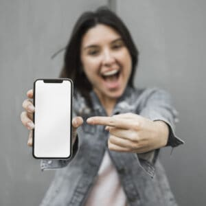 happy woman holding loyalty app in phone up pointing
