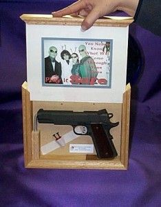 hidden gun in picture frame