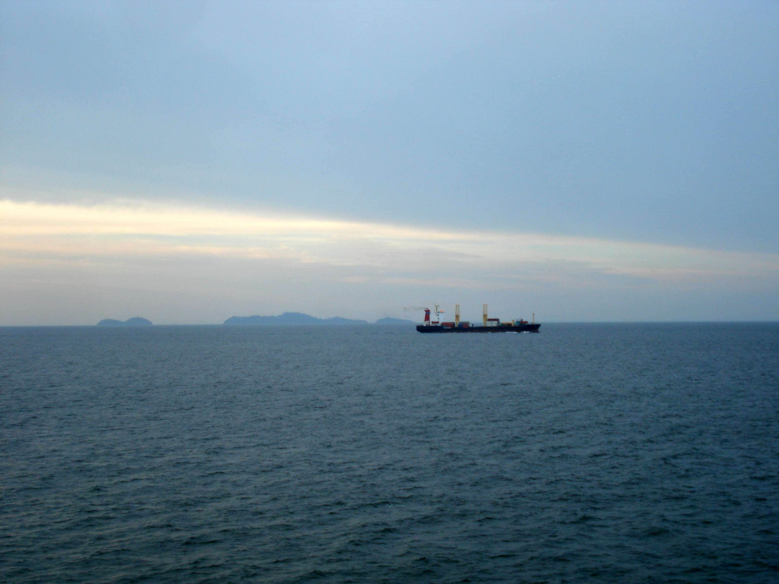 A ship passes through the Strait of Malacca chokepoint on June 5, 2009. (Image Credit: Wikimedia Commons/XEON)