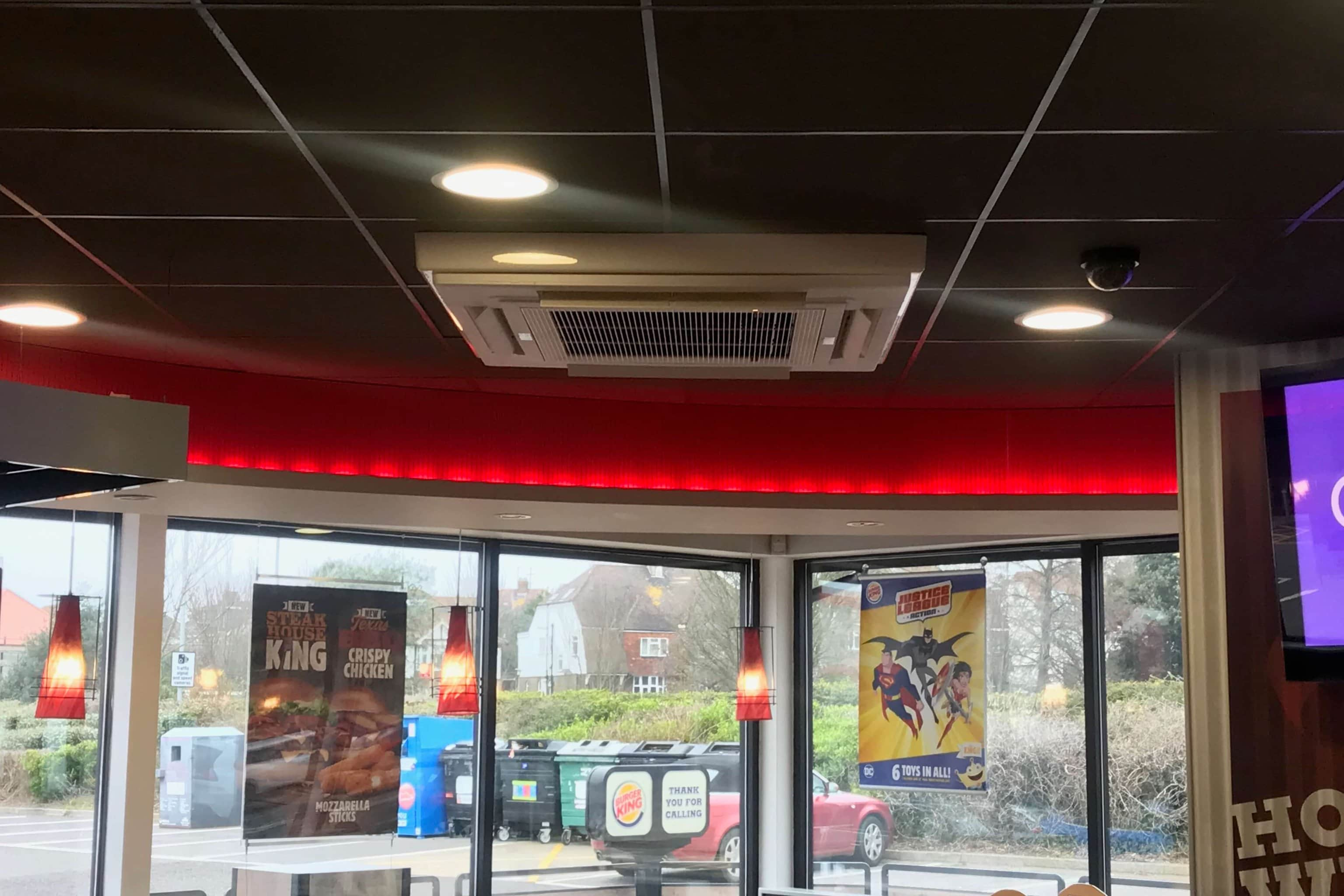 A ceiling air conditioning unit installed in a Burger King restaurant