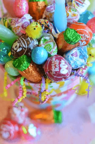 Sucker bouquets are an easy DIY and simple gift. Learn how to make a lollipop pop centerpiece with any type of sucker or dum dums for your next party, baby shower, birthday or a school carnival. This is an inexpensive DIY!