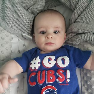 Reese's baby in a cubs onesie.