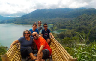 Joe From T.O., Charo, Marco, Daniela and Mateo sitting with the view of twin lake, Bali