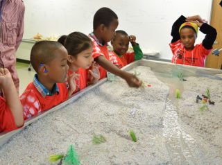 Children using an Emriver Em2 Stream Table