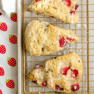 Homemade strawberry scones with powdered sugar glaze