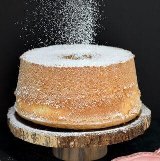 a vanilla chiffon cake on a cake stand