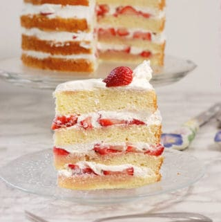 a slice of strawberry tall cake