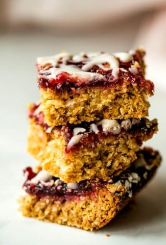raspberry coconut oatmeal bars stacked on a table