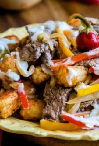 tater tot nachos with steak, onions, and peppers