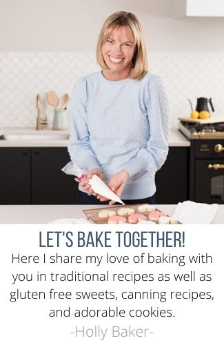 Bio Picture of Holly Baker for A Baker's House Holly in kitchen icing cookies