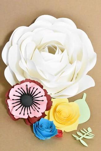 paper flowers used to embellish kids' art display