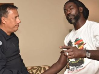 Buju Banton and the head of the Trinidad Police Department.