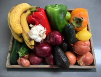 Wooden dish full of colorful vegetables