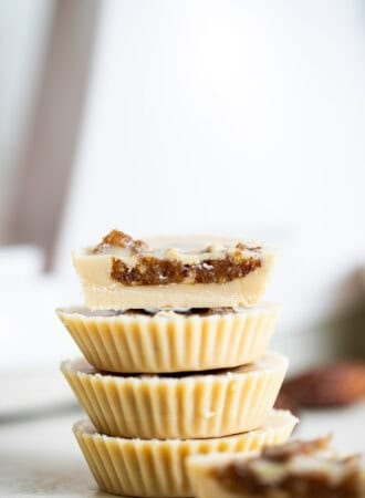 A stack of tahini cups filled with date caramel.