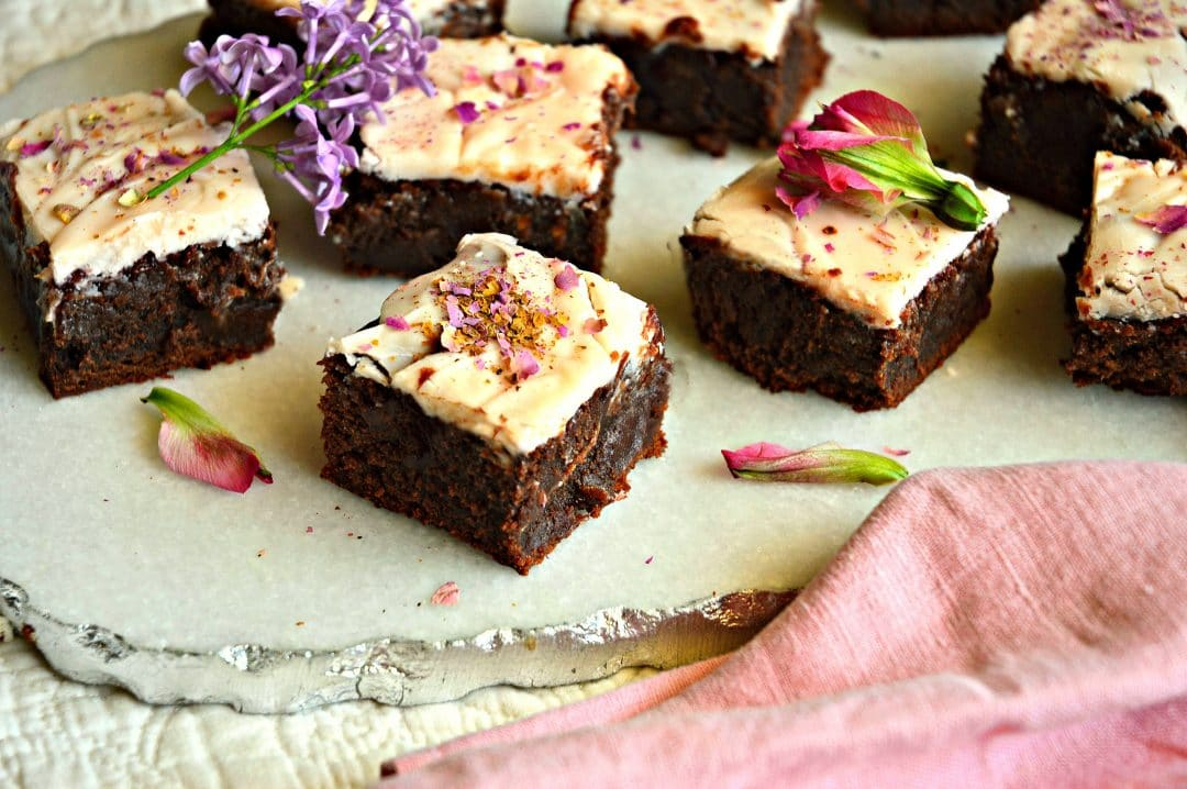 These fudgy chocolate rosewater brownies with white chocolate frosting are made from a classic recipe. The addition of rosewater makes them unique and addicting. #rosewater #brownies #baking #cookies #dessert See more at This is How I Cook.