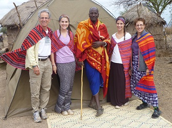 family on vacation with masai in tanzania