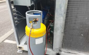 Chilling plant service showing yellow top recovery cylinder with gauge line and sight glass fitted