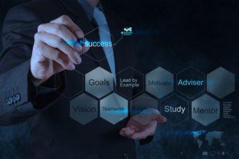 businessman hand shows diagram of business success chart concept