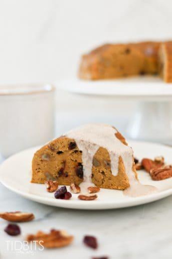A slice of pumpkin breakfast cake on a white plate