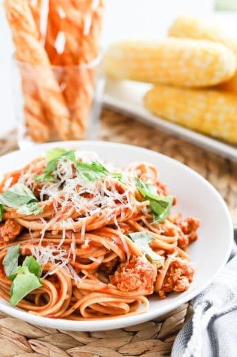Bowl of spaghetti with fresh basil