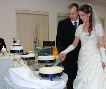 Bride Cutting Homemade Wedding Cake