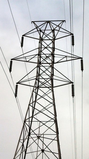 Figure 2. Run along the top of the steel towers, the static ground-wire serves as a type of lightning arrester