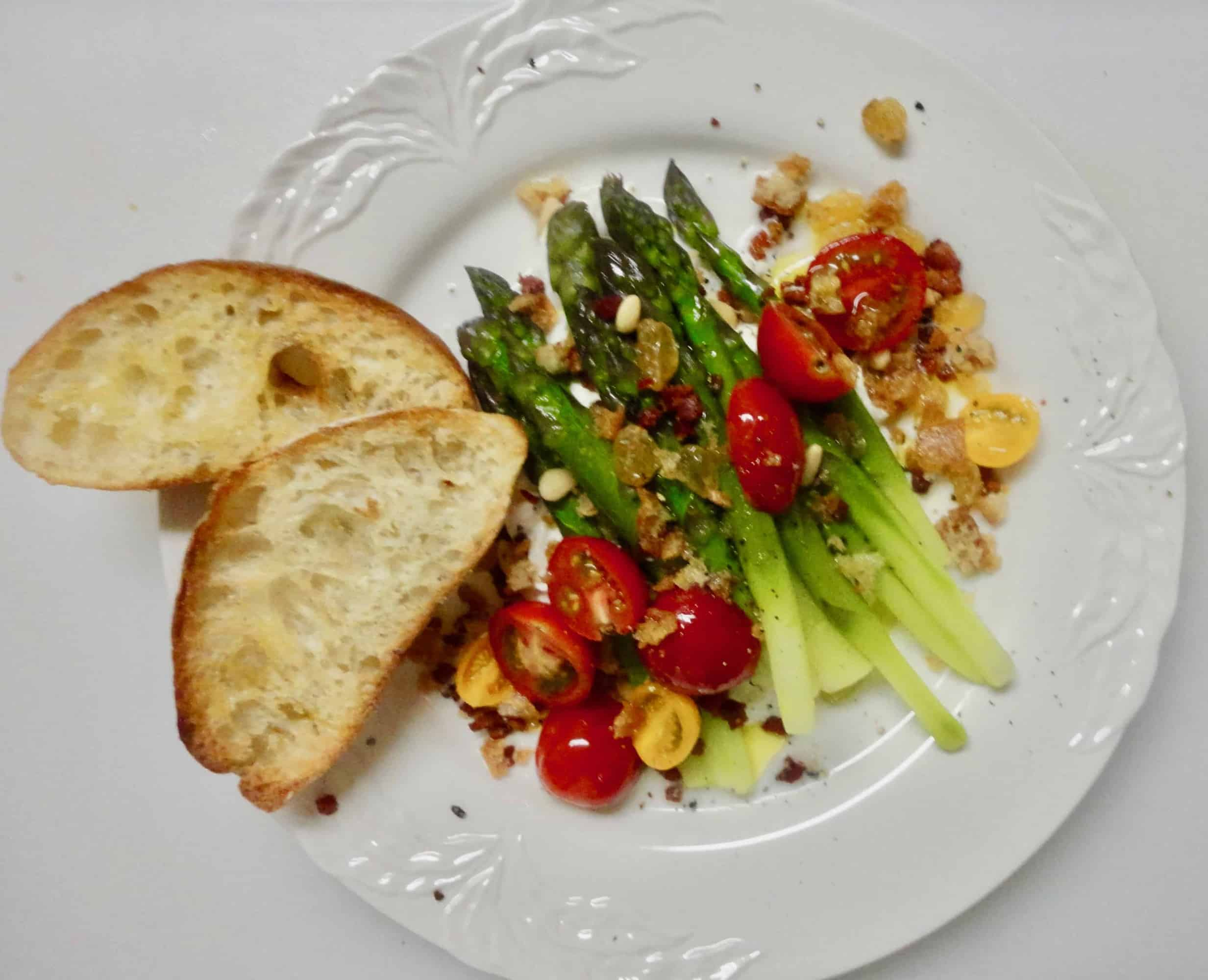 Fresh Asparagus Salad with Buratta, Pancetta, Pine Nuts, Raisins and Bread Crumbs and Tiny Tomatoes