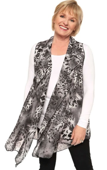 Asymmetrical vests are great at hiding the bely | 40plusstyle.com