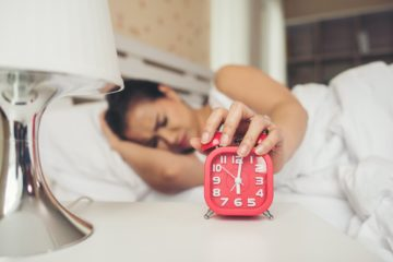 Girl Snoozing Alarm Due To Laziness