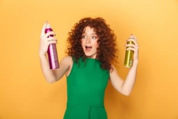girl using pollutant hairspray