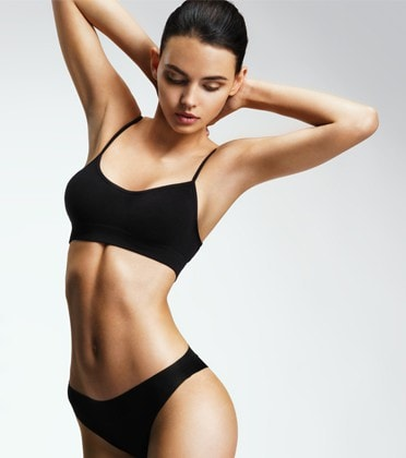 A girl with a fit body after body sculpting