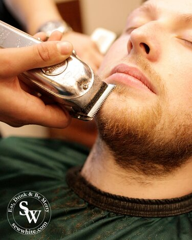 Close shave the pavement barbers in Wimbledon