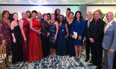 Kevin Hendrickson (third from right) is joined by Courtleigh Hospitality Group staff and family members in celebrating his AMCHAM Jamaica President's Award.