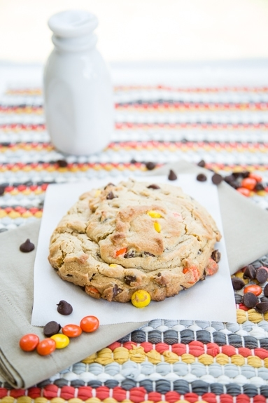 single serve cookie studded with reese's pieces and chocolate chips