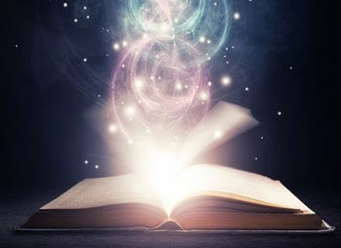glowing book opening to wisdom