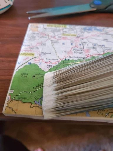 Map coaster being brushed with clear mod podge.
