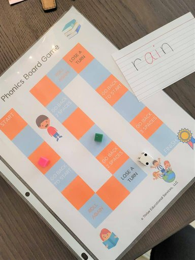 printable phonics board game for long u words activity